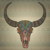 Decorative indian bull skull in tribal style on ornamental Royalty Free Stock Images