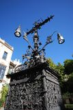 Decorative Iron cross and lamp, Seville, Spain. Ornate iron cross and lanterns in the Plaza Santa Cruz, Seville, Seville Province, Andalusia, Spain, Europe royalty free stock photos