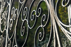 Decorative iron fence with round helixes Stock Images