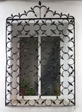 Decorative iron grill over residential window. Wrought Iron Grill or bars on Window in Malaga, Andalusia Stock Images