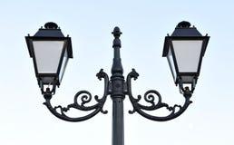 Decorative iron lantern with double swirls. Royalty Free Stock Photo