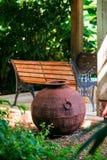 Decorative iron metal pot by gazebo relaxing space environment garden zen design.  stock images