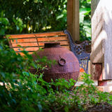 Decorative iron metal pot by gazebo relaxing space environment garden zen design square.  royalty free stock photo