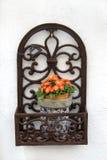 Decorative ironwork and flowerpot Stock Photography