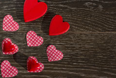 Decorative items for the celebration of Valentine`s Day on a wooden background. Postcard or background on Valentine`s Day Royalty Free Stock Images