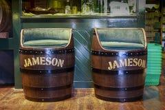 Decorative Jameson Irish whiskey barrel armchairs. CORK, IRELAND - JUNE 20, 2008: Decorative Jameson Irish whiskey barrel armchairs at the Jameson Heritage royalty free stock photo