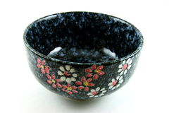 Decorative Japanese bowl. Hand painted flowers on black Japanese bowl isolated on white background stock photography