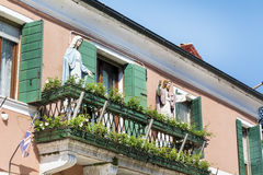 Decorative Jesus and Mary statues on a balcony in Burano Island,Italy royalty free stock photos