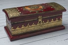 Decorative jewelery box in red with gold stock photo