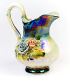 Decorative jug. Colorful flowers hand painted on jug, isolated on white background stock photos