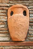 Decorative jug on the wall Stock Photo