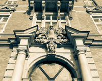 Decorative Keystone with Sculpture and Plaque. Low angle horizontal black and white split toning photography Stock Photos