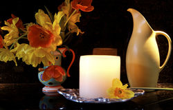 Decorative Kitchen Counter. Vase of crocus, candle and pitcher on a kitchen counter stock photos