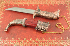 Decorative knife. Decorative asian knife with horses head and shield Stock Images