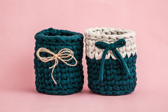 Decorative Knitted Green Baskets with Ribbons Stock Images