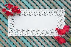 Decorative lace napkin on an old wooden surface Stock Photo