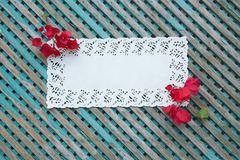 Decorative lace napkin on an old wooden surface Royalty Free Stock Images