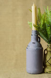 Decorative lamp with fern and ceramic jug with a candle. Stock Images