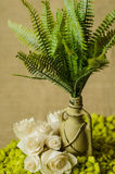 Decorative lamp with ferns and green stone and paper roses top view. Royalty Free Stock Photos