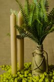 Decorative lamp with ferns and green stone and two candles top view. Royalty Free Stock Photo