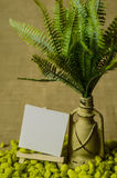 Decorative lamp with ferns and paper labels with easel. Royalty Free Stock Images