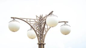 Decorative lamppost. With four huge bulb,  with sky Royalty Free Stock Images