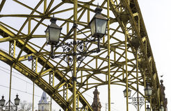Decorative lamps hanging from bridge Stock Images