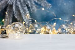 Decorative lamps for illumination, blurred decorative christmas. Decorative light lamp for illumination, blurred decorative christmas garland on blue background stock photo