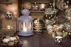 Decorative lantern, candles and Christmas decorations Stock Photos