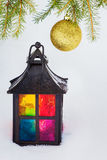 Decorative lantern  and fur-tree branch with Christmas ball Stock Photo