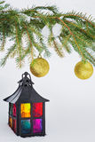 Decorative lantern and fur-tree branch with Christmas balls Royalty Free Stock Photo