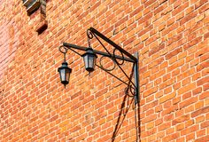 Decorative lantern hanging on an old brick wall. Vintage decorative lantern hanging on an old brick wall Royalty Free Stock Images