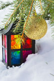 Decorative lantern in the snow and fur-tree branch with Christma Royalty Free Stock Images
