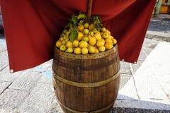Decorative lemons on wooden barrel. Group stock image