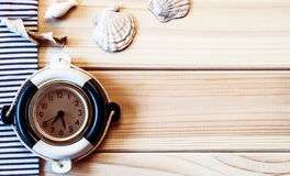 Decorative lifebuoy on the background of of wooden boards Stock Photography