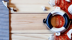 Decorative lifebuoy on the background of of wooden boards Stock Photos