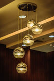 Decorative light bulb glowing in cafe. Stock Images