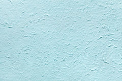 Decorative light soft blue color paper, imitates the old plaster or vintage azure surface of the facade. Stock Image