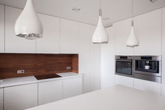 Decorative lighting in contemporary kitchen Stock Photos