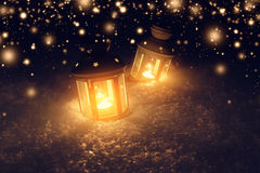 Decorative lights in snow at christmas night royalty free stock photography