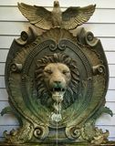 Decorative Lion Fountain. Antique finish decorative lion water fountain with clamshell shaped reservoir. Located in Dallas, TX Royalty Free Stock Images