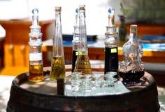 Decorative liquor bottles Stock Photos