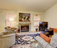 Decorative living room with beautiful rug. Decorative libing room with nice rug, and fireplace Royalty Free Stock Images