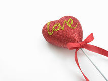Decorative love heart. Decorative red love heart with ribbon, isolated on white background Stock Photo