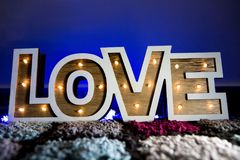 Decorative Love Lights. On colorful carpet with Blue Ambient Light Stock Image