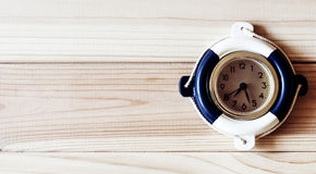 Decorative marine clock on the background of wooden boards Stock Photography