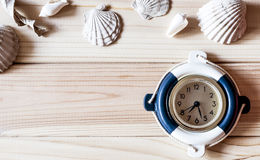 Decorative marine clock on the background of wooden boards Stock Photo