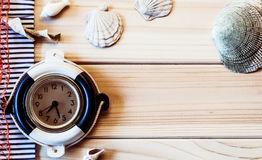 Decorative marine clock on the background of wooden boards Royalty Free Stock Images