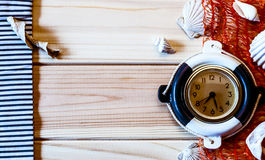 Decorative marine clock on the background of wooden boards Stock Image
