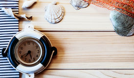 Decorative marine clock on the background of wooden boards Stock Images